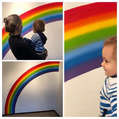 Collage muurschildering regenboog